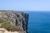 Rocky Cliff Of The Algarve Coastline In Sagres, Portugal