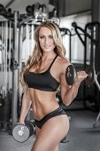 Blonde Bodybuilder Workout In Gym