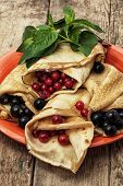 pancakes stuffed with red and black currants