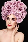 Portrait of young beautiful woman in fancy flower wig