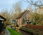 Dutch house with a thatched roof  in Giethoorn, Netherlands.