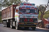 Decorated And Painted Heavy Dump Truck On The Road In India.