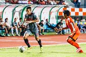 Sisaket Thailand-june 29: Ekkachai Sumrei Of Bangkok Utd. (grey) In Action During Thai Premier Leagu