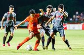 Sisaket Thailand-june 29: Sarayuth Chaikamdee Of Sisaket Fc. (orange) In Action During Thai Premier