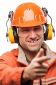 Construction building engineer or manual worker man in safety hardhat helmet finger pointing white i