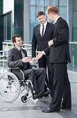 Man On Wheelchair Before Business Meeting