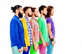 Portrait in profile of group of modern bearded men standing in a row. Isolated over white.