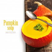 Pumpkin soup for halloween party or thanksgiving day concept (with easy removable sample text)