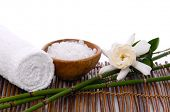 Spa setting with towel and, bamboo grove ,salt in bowl , Gardenia on mat
