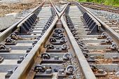 stock photo of railroad yard  - The railroad tracks and redirects the intersection.