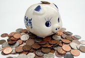 Old Piggy Bank And Coins