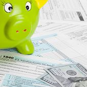 United States Of America Tax Form 1040 With Green Piggy Bank
