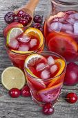 stock photo of refreshing  - Ice refreshing summer drink with lots of different fruits - JPG