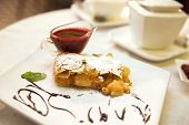 Pear And Raisins Strudel With Berry Sauce