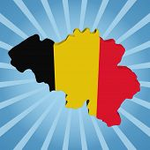 Belgium map flag on blue sunburst illustration
