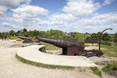 Cannons And Tourists On The Fortification Island Suomenlinna