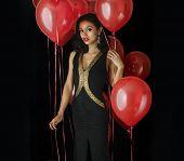 Beautiful elegant young woman wearing black dress