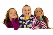 pic of pajamas  - Three children wearing pajamas hands on chin - JPG