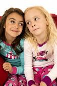 Adorable Young Girls Portrait Looking At Each Other
