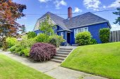 Clapboard Siding House In Blue Color With Tile Roof