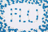 Flu Word Text Made Of Blue Tablets, Pills And Capsules