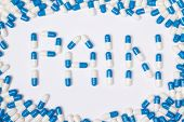 Pain Word Text Made Of Blue Tablets, Pills And Capsules