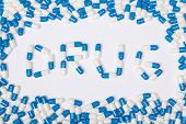 Drug Word Text Made Of Blue Tablets, Pills And Capsules