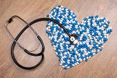 Stethoscope And Heart Made Of Blue Tablets, Pills Or Capsules