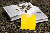 Close Up Picture Of Tea Bags And Dried Tea Leaves With Blank Paper
