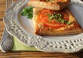 puff pastry with tomatoes, cheese and herbs