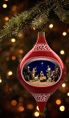 pic of christmas ornament  - Christmas ornament feathering a diorama of the nativity - JPG