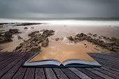 Long Exposure Landscape Beach Scene With Moody Sky Conceptual Book Image