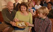 stock photo of stewardship  - A Sunday morning church congregation putting money in the offering plate - JPG