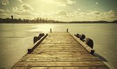 stock photo of pier a lake  - Vintage retro toned image of a pier on frozen lake - JPG