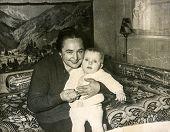 SZCZECINEK, POLAND, APRIL 12, 1962: Vintage photo of  grandmother with her baby grandchild