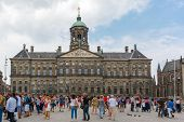Tourists In Front Of The Royal Palace On Dam Square In Amsterdam