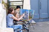 Young Artists Paint The Saint Sophia Cathedral At Novgorod Kremlin In Sunny Day