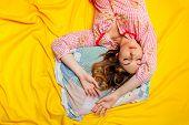 girl sleeping on the yellow sheet