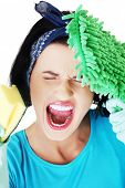 Portrait of screaming woman with a mop and sponge.