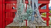 Fishing Nets Blue And Green Hanging On The Fence Or Porch Red, Fishnets Carefully Picked