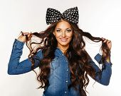 foto of hair bow  - Photo of a beautiful girl with long hair and a bow on her head - JPG