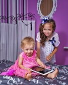 Little Sisters And Tablet Pc