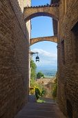 Historic Street Of Assisi With Views Of The Umbrian Countryside