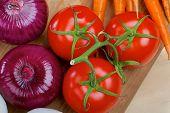 Three ripe tomatos and purple onions