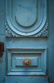 Brass Door Handle On A Rustic Blue Door