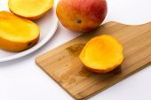 stock photo of flesh  - Golden yellow third of a trisected mango - JPG