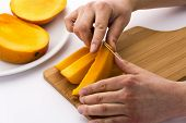 Peeling Away The Mango Skin From A Fruit Chip
