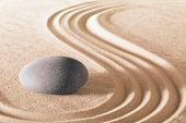 pic of calm  - zen stone garden round stone and raked sand making line patterns tranquil scene for relaxation and meditation simplicity and balance are the base of a Japanese garden nice calm spa background  - JPG