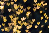 Small golden hearts bokeh background, abstract bokeh