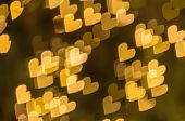 Abstract yellow hearts bokeh background